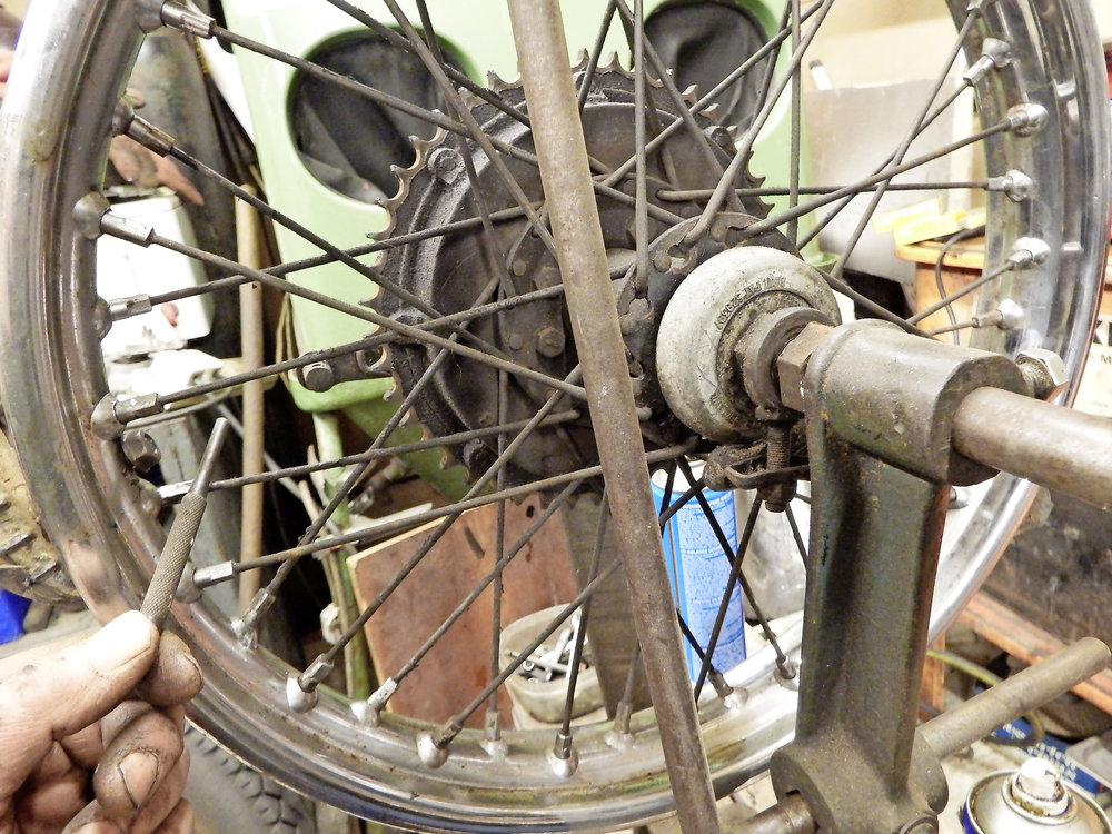 1.  You should get a 'ping' note from a correctly tensioned spoke. Rattling or a flat noise indicates the spoke has lost some of its tension, increasing the strain on its neighbours.