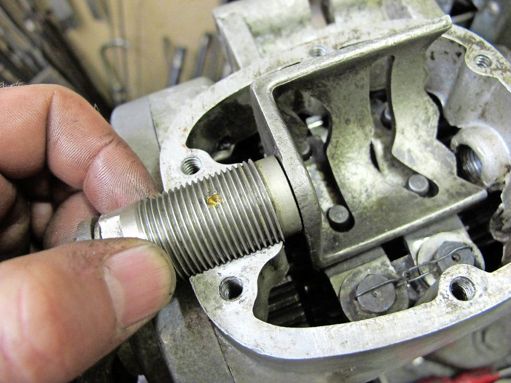 1.  The Rudge gearbox is unusual in that the camplate's position, relative to the selector forks, is adjustable by means of its threaded pivot bush.