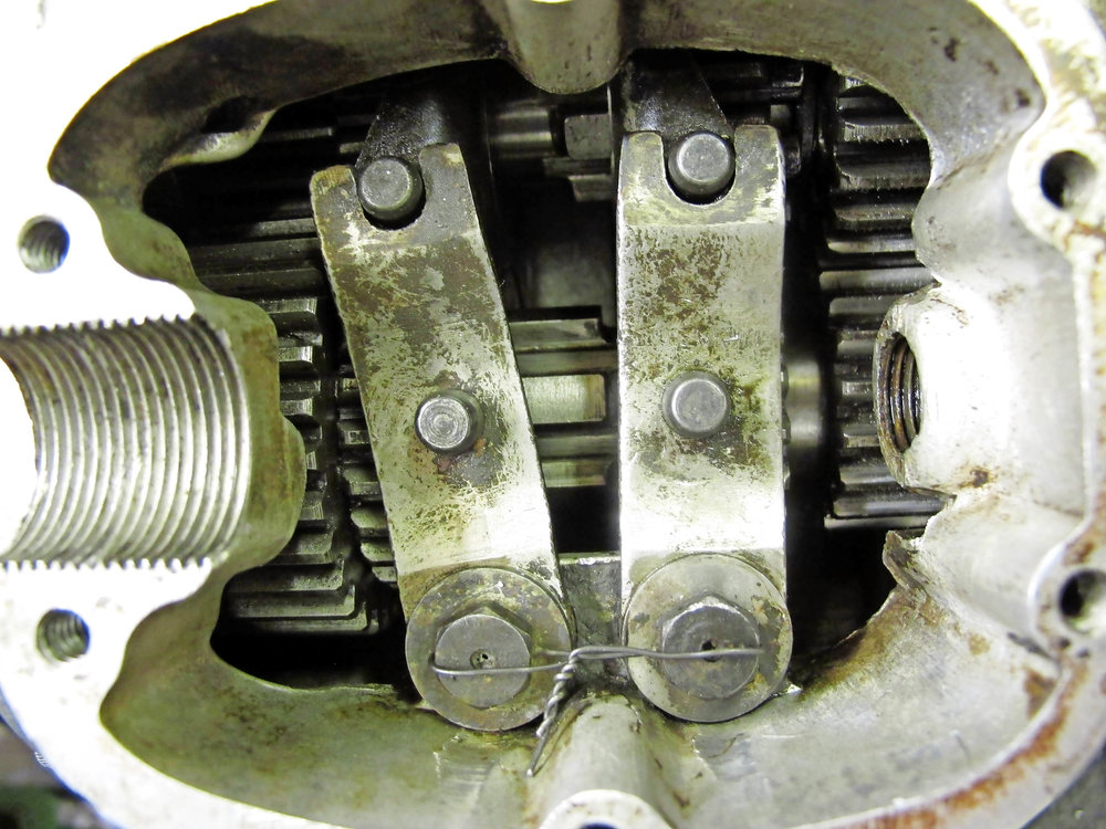 2.  In first gear (camplate removed for view) all looks well. The two gears bottom left are snuggled together, while the two gears top right (fourth) are well separated.