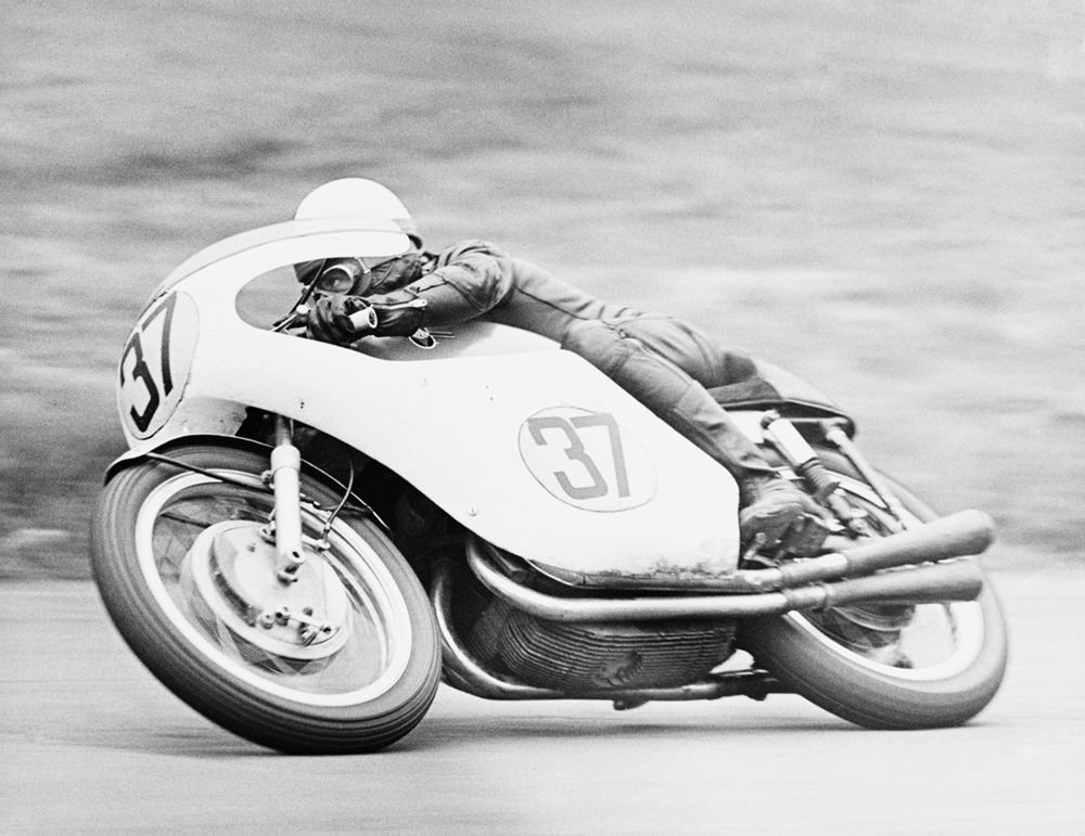 The recently departed and magnificently enigmatic Derek Minter on a factory Gilera four in the '60s