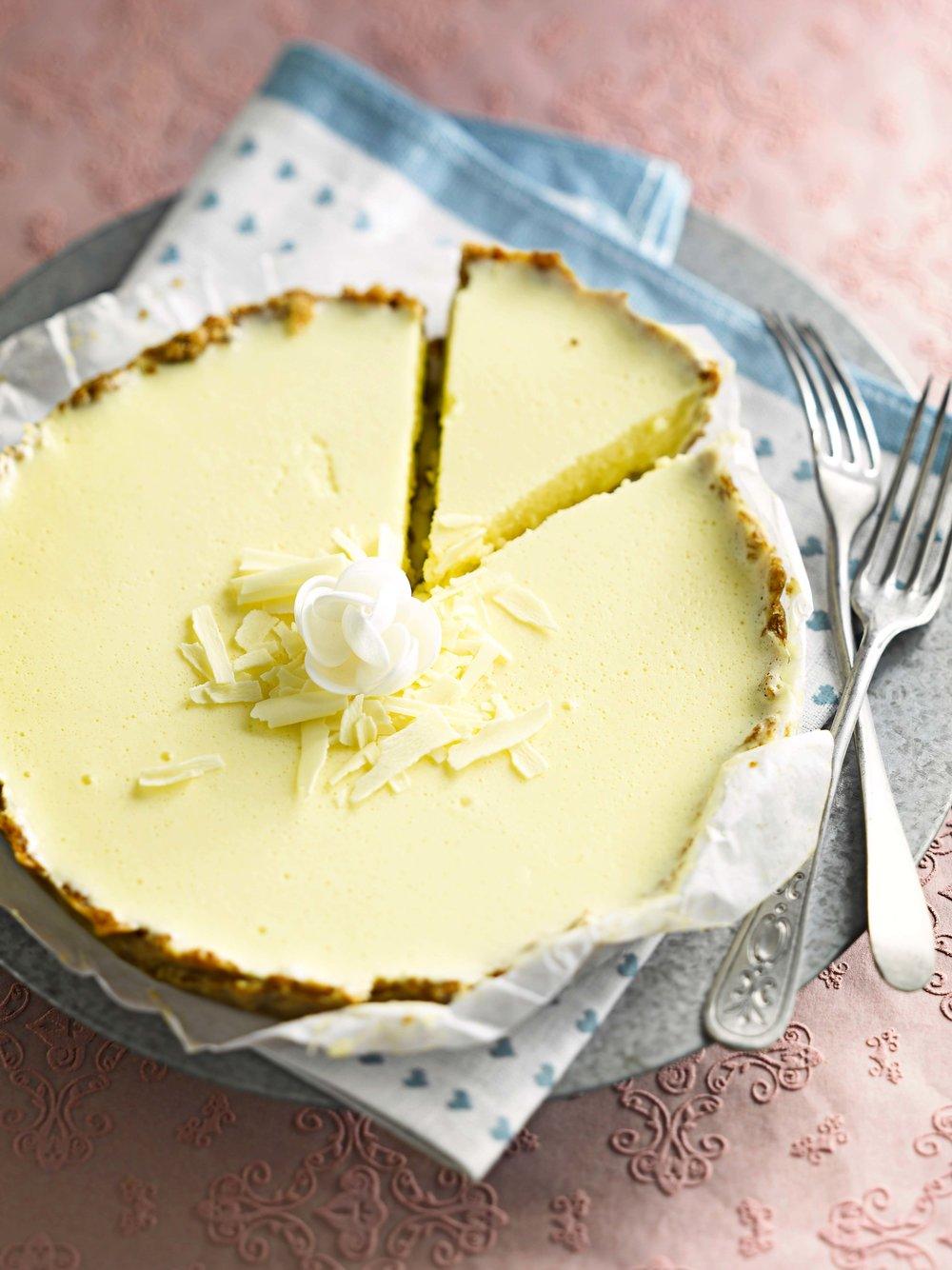 A slice of white chocolate cheesecake, a perfect springtime treat, from a recipe in the May 2018 issue of LandScape
