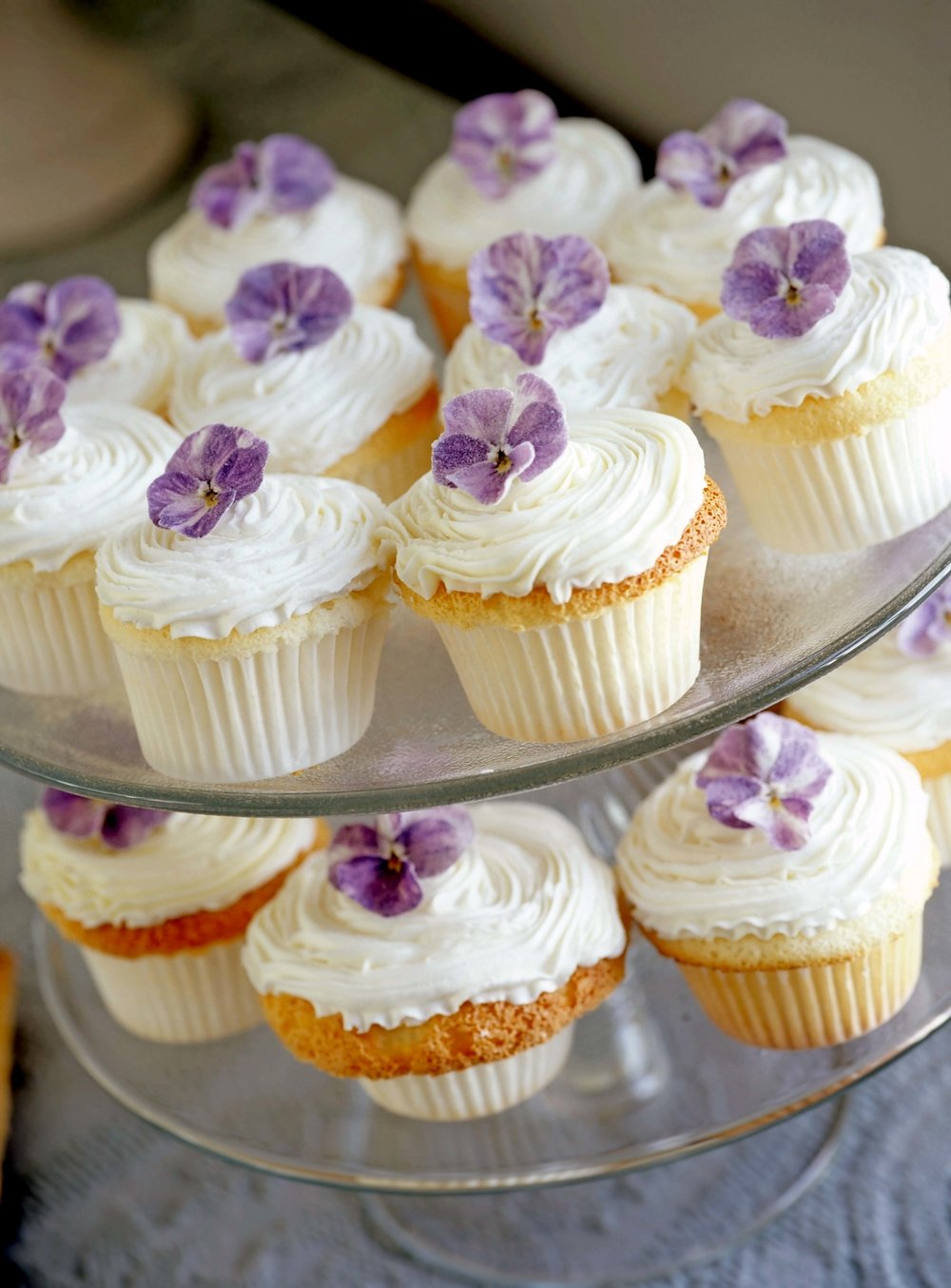 Sugared viola flowers add a delicate touch to this cupcake recipe. From the April 2018 issue of LandScape