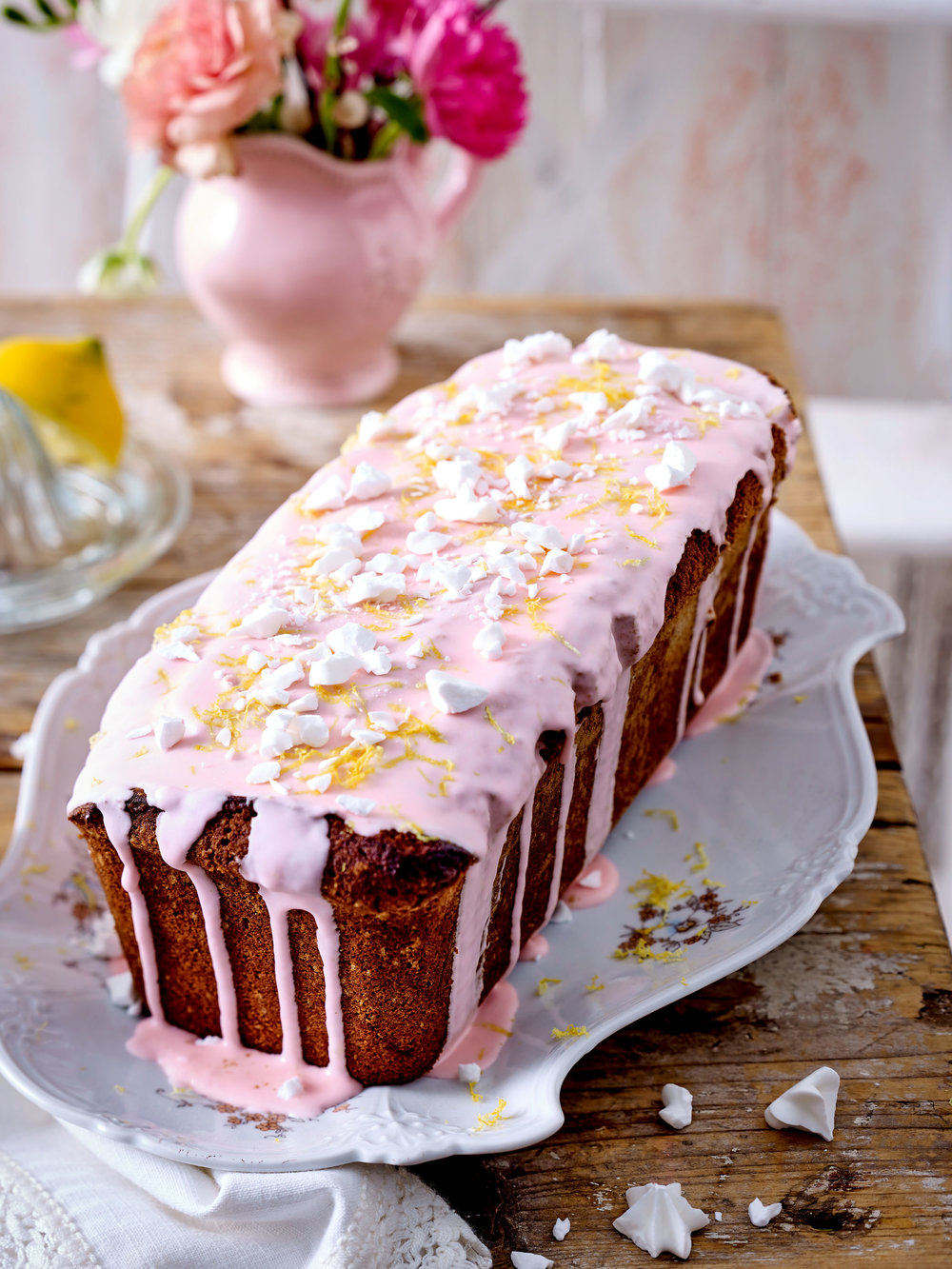 Drizzled with lemon flavour icing and scattered with crushed lemon sugar rosettes, this is a gorgeous teatime treat.
