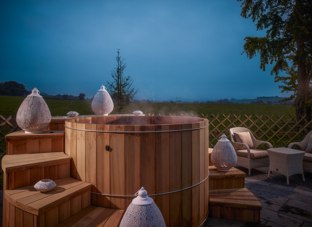 The outdoor hot tub at the Spa at Fishmore Hall, Ludlow