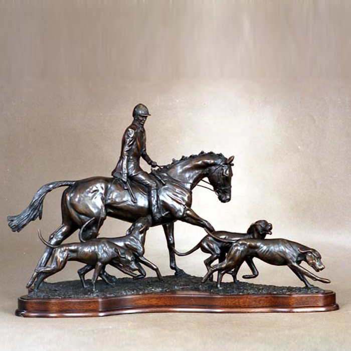 "Huntsman and Hounds - bronze Limited Edition (from back catalogue) by Gill Parker: ""Living in the Gloucestershire countryside, this is a scene that is very familiar. Again, I love to tell a story and explore the interaction between the huntsman and hounds."""