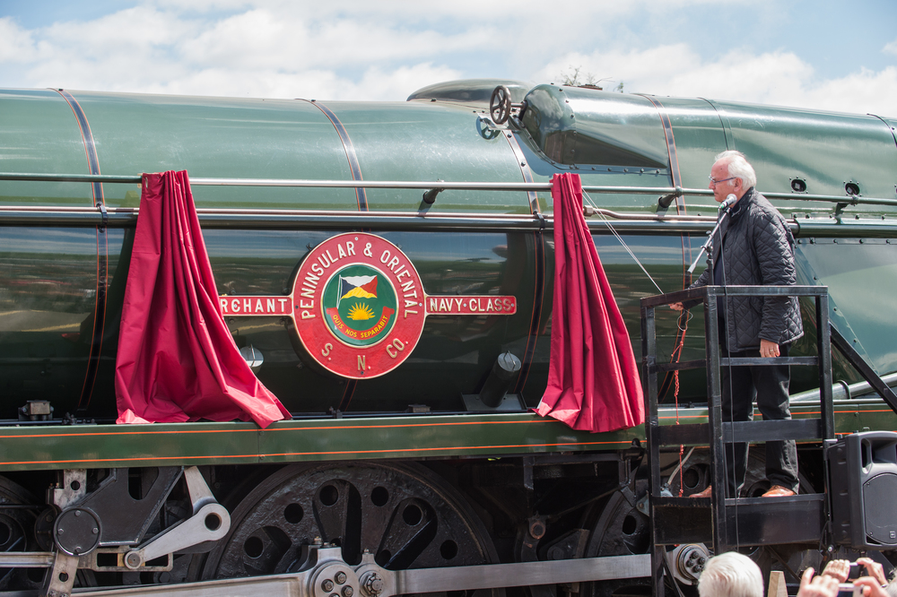'GlosWarks' President, Pete Waterman, unveils the nameplates for 'Merchant Navy' No. 35006  Peninsular & Oriental S. N. Co  - the longest name applied to a member of the class. Credit: Jack Boskett