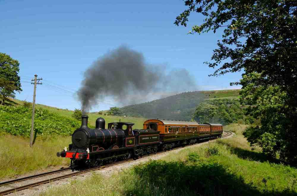 'Ironclad' 0-6-0 No. 957 climbs out of Damems loop with a complete train of Lancashire & Yorkshire Railway carriages on July 22 2012.  KARL HEATH