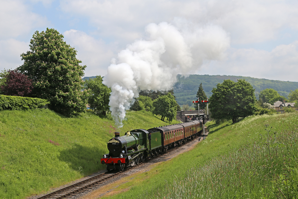 Fresh from overhaul, the GWSR's 'Modified Hall' No. 7903 Foremarke Hall pulls away from Winchcombe station with a southbound train to Cheltenham Racecourse at the railway's Cotswold Festival of Steam gala. Credit: MALCOLM RANIERI