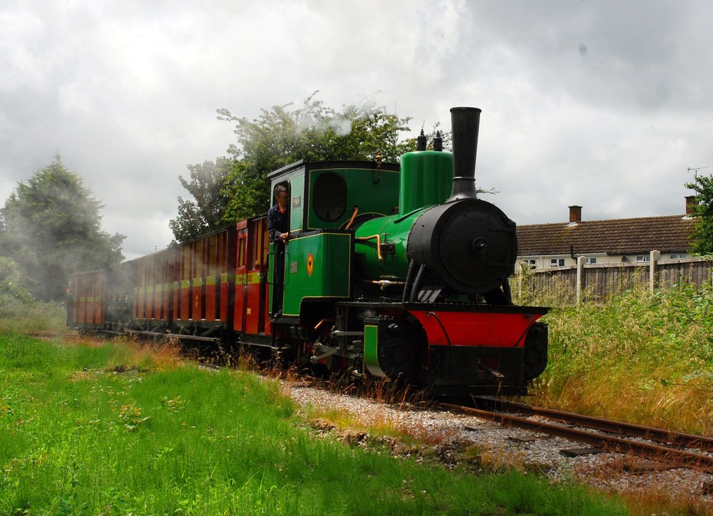 The largest locomotive in the Leighton Buzzard Railway's fleet, O&K 0-6-0WT Pedemoura, hauls a loaded test train over the 2ft gauge line on June 20. ALF FISHER
