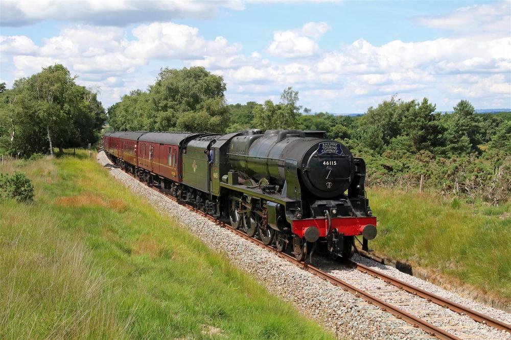 Making its debut on the Swanage Railway, rebuilt 'Royal Scot' No. 46115 Scots Guardsman hauls the RTC's 'Swanage Belle' over the railway's recently opened extension near Furzebrook on July 14. ANDREW P.M. WRIGHT