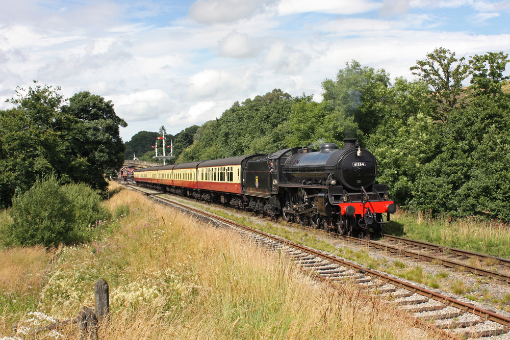 In its first week back in service since 2014, Thompson 'B1' No. 61264 departs Goathland station with the 12:45 Whitby to Pickering service on August 3 with a rake of 'blood and custard' coaches. PHILIP BENHAM