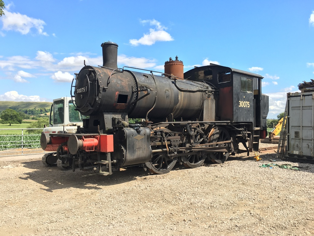 Looking substantially different from when it arrived in January, 'Yugo Yankee' 0-6-0T No. 30075 stands outside Shillingstone station minus its side tanks, sand boxes and steam dome cover. TOM HOMEWOOD
