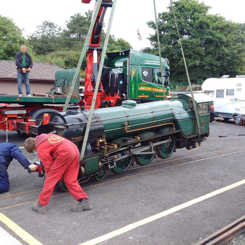 Gently does it - RHDR No. 7 Typhoon is lowered onto the rails at Ravenglass. RER