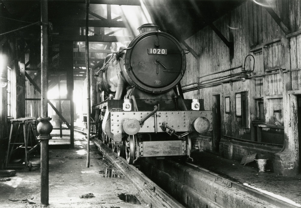 The smokebox door is arguably the face of an engine. Shafts of sunlight stream through the roof of Neyland shed onto Hawksworth 'County' No. 1020 County of Monmouth on May 8 1961. FRANK CASSELL