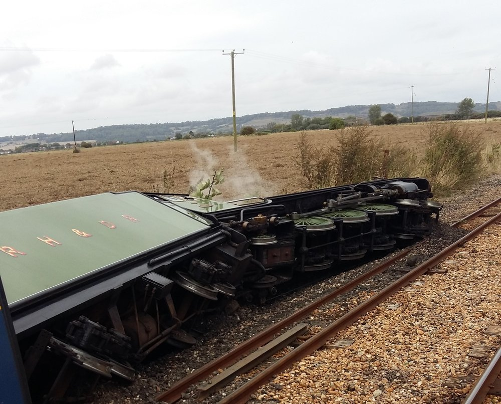 Green Goddess lies on her side after colliding with a tractor at an unmanned level crossing on the Romney, Hythe & Dymchurch Railway on September 10. KIM RICHARDSON