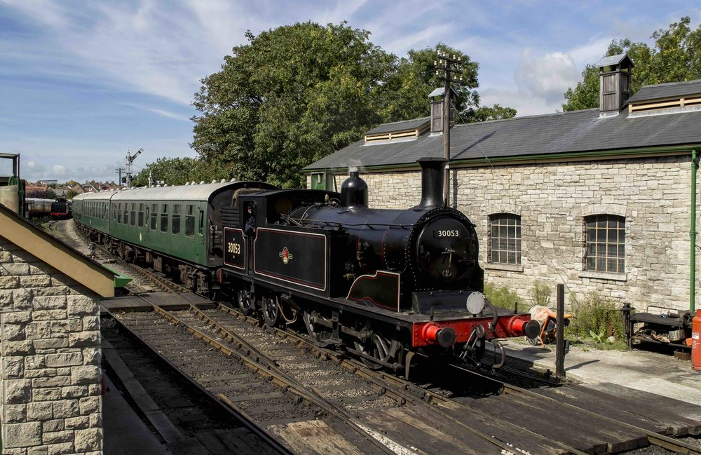 LSWR 0-4-4T 'M7' No. 30053 coasts into Swanage station with the midday service from Norden on September 1. SAM MIDDLETON