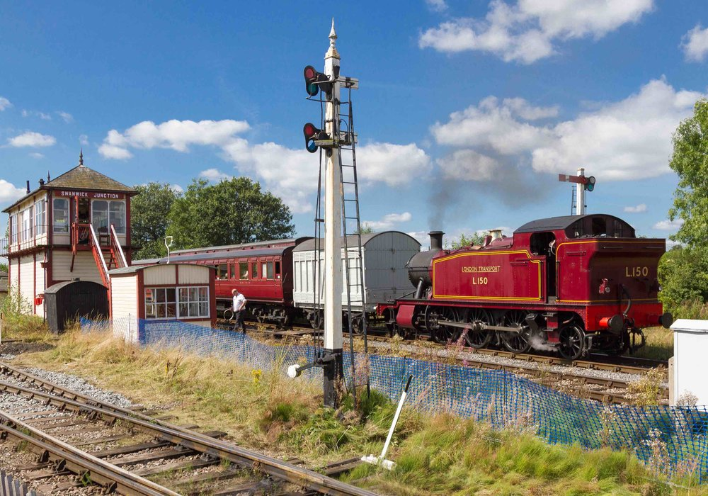 Passing Swanwick Junction signal box on the Midland Railway - Butterley is 'Small Prairie' 2-6-2T No. L150 with a vintage train set on August 29. ALAN WEAVER