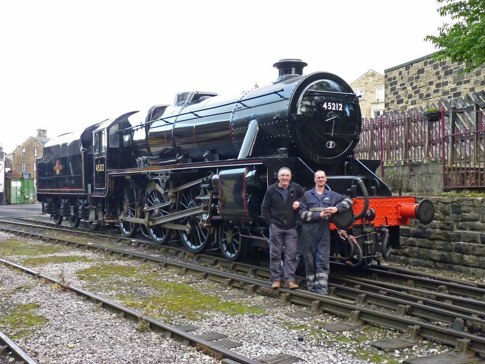 Fresh from overhaul at Riley & Son (E) Ltd, 'Black Five' No. 45212 stands in Haworth yard following re-painting by Peter Whitaker and Tim Hanson (pictured) on October 4 2016. COLIN SMITH