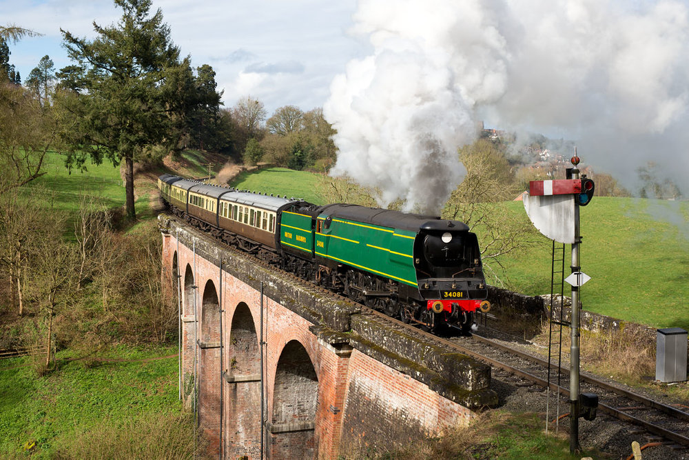In unfamiliar surroundings, visiting 'Battle of Britain' No. 34081 92 Squadron crosses Oldbury Viaduct on the Severn Valley Railway with a rake of Collett stock on March 20 for a Battle of Britain Locomotive Society photo charter. IAN BOWSKILL