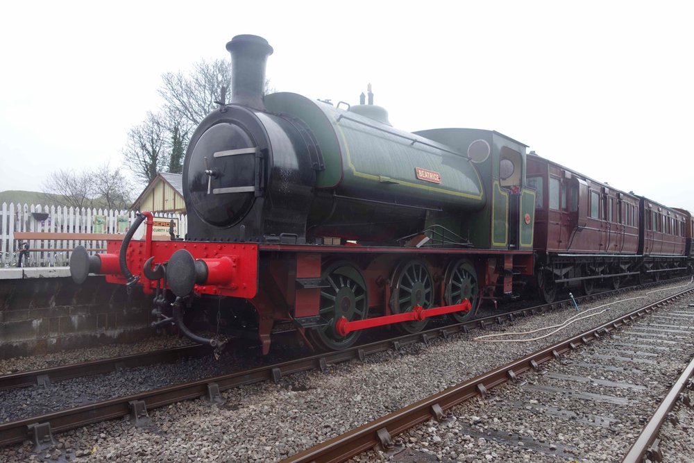 Destined for Tunbridge Wells: Hunslet 0-6-0ST  Beatrice  stands at Bolton Abbey station on November 9 2015. The six-wheel coaches are Great Eastern Railway Nos. 14 and 37 from Stephen Middleton's Stately Trains fleet. RICHARD HAMPSON/SR.