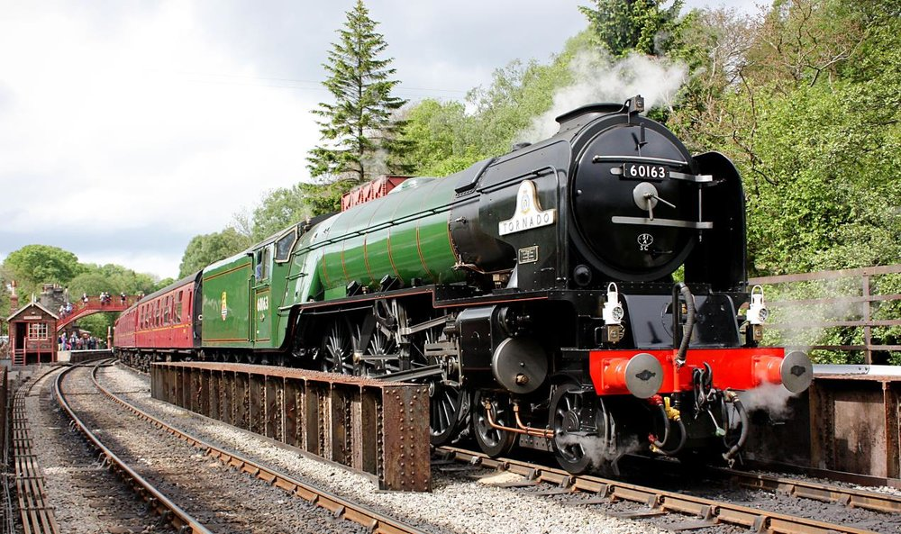 On a previous visit to the NYMR and in BR express passenger green, new-build 'A1' No. 60163 Tornado prepares to depart Goathland with a train bound for Pickering. NYMR