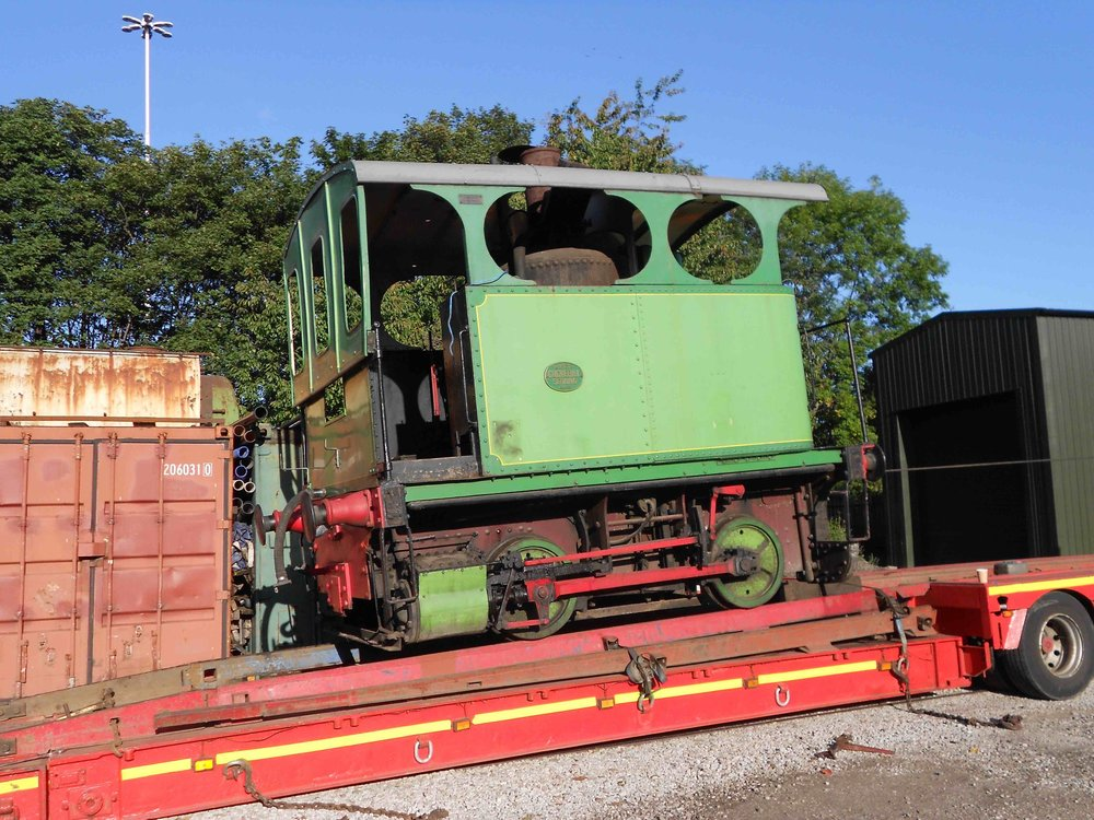 Cockerill 0-4-0VBT steam tram 'Lucie' is manoeuvred onto the back of a low loader on September 12, ready to leave the Middleton Railway for its journey to Grosmont. MIDDLETON RAILWAY