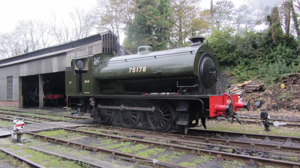 Resplendent in WD khaki livery, newly restored 'Austerity' No. 75178 rests outside Bodmin General shed on October 14. JIMMY JAMES