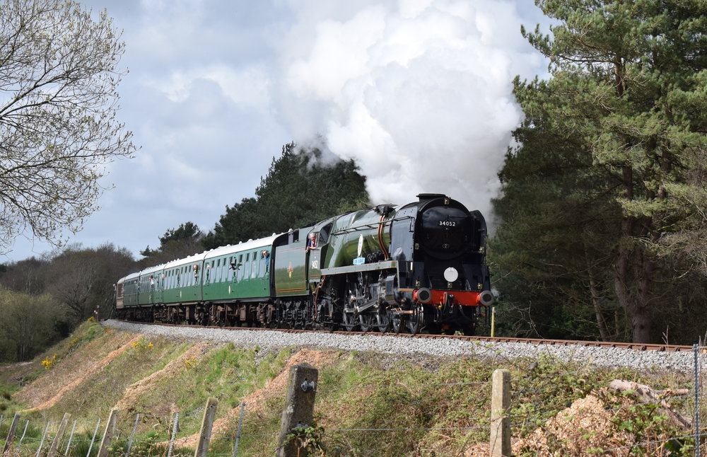 Part of Saphos Trains' initial main line steam fleet, 'West Country' No. 34046  Braunton  (running as 'Battle of Britain' No. 34052  Lord Dowding ) climbs towards Norden at the Swanage Railway's 'Strictly Bulleid' gala on April 1. THOMAS BRIGHT/SR