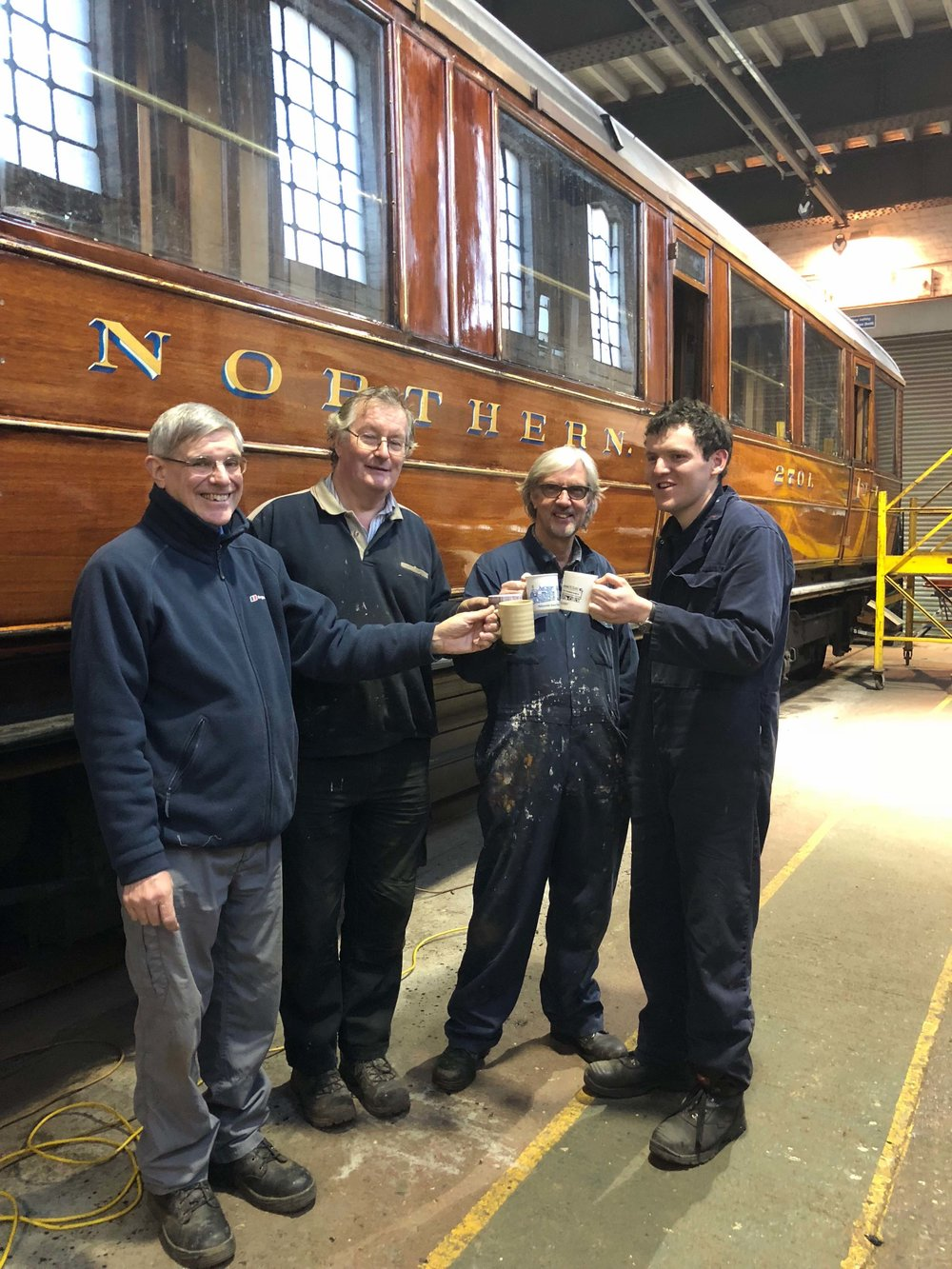 Derek Stagg, Hugh McQuade, John Beck and James Broughton celebrate the success of the £10,000 appeal during their tea break at the SVR's Kidderminster workshops. SVR