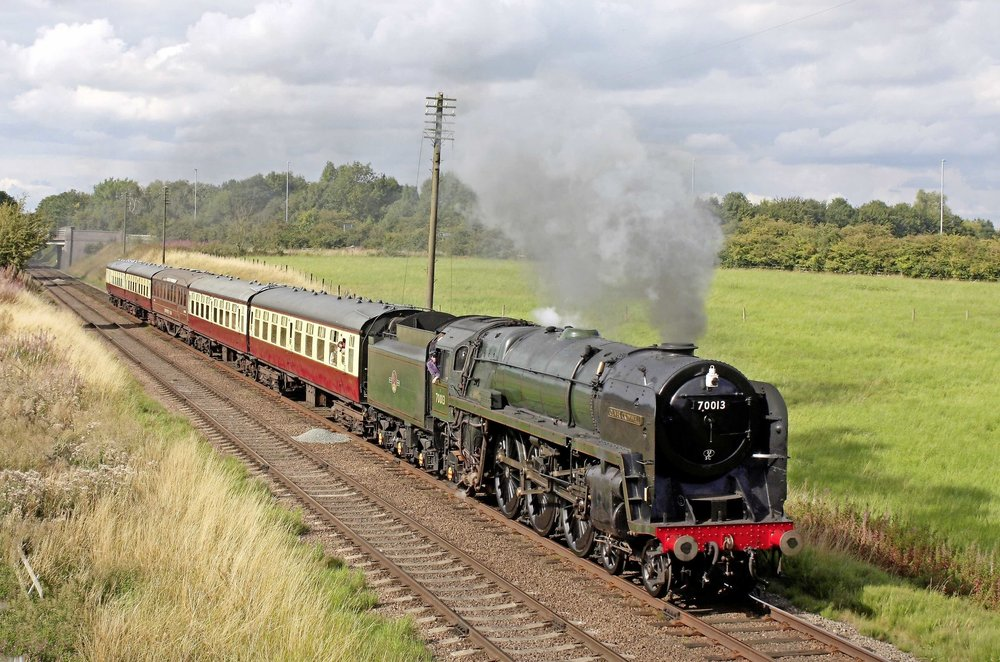 Confirmed for the Keighley & Worth Valley 'Spring Gala' on March 9-11, 'Brit' No. 70013  Oliver Cromwell  passes Woodthorpe on the Great Central Railway on August 12 2017. PAUL BIGGS