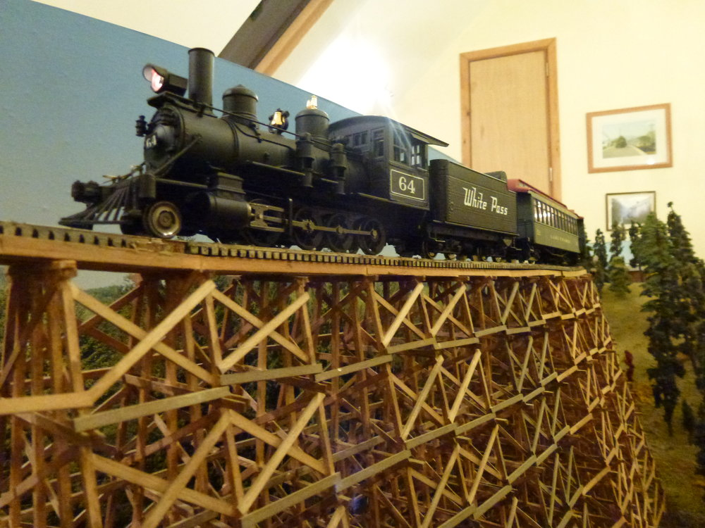 Out of scale, but posed briefly on my 'HO' trestle bridge the Broadway 2-8-0 has had a repaint from its Christmas livery.