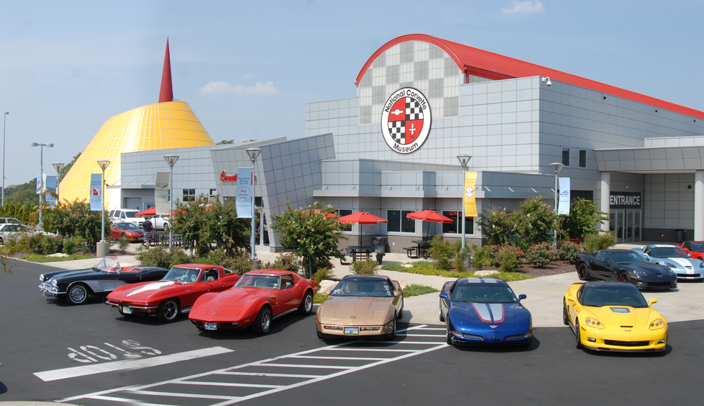 "David Taylor, CM's production editor, visits this Kentucky shrine to the iconic US sports car   ""What the hell is that?"" Approaching the National Corvette Museum at Bowling Green in Kentucky, your eyes are immediately drawn to a huge ovoid structure towering over the surrounding buildings at the side of Interstate 65, like a giant yellow egg topped with a huge red needle. This is the museum's Skydome and there are several theories about what it is meant to represent. Some suggest it's inspired by the rear light fitting on the original Corvette. Others say that, when seen from the sky, it represents a speedometer with its needle arcing into the redline. In fact, the architects of the museum had only one thing in mind when they designed the Skydome: that everyone passing the site would see it and go ""What the hell is that?"" The Skydome has taken on an ominous significance since February 12, 2014. In the early hours of that morning, a sinkhole opened up directly beneath it, swallowing eight rare Corvettes in the process, and threatening to collapse the entire structure. More than a year on, it's still standing and in the process of transformation. But more about that later…"