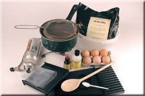 1. All of the items that you'll require to make your own boilies. Eggs, base mix, flavours, mixing bowl, saucepan, sieve, measuring spoons, rolling table, stove.