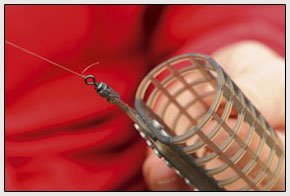 8. Now attach your cage feeder to the reel line, again using a proven knot like a grinner or half-blood. Leave a small tag end on the knot as to account for any slippage