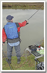 2. Lift the rod up and away from the float to gather the excess line causing the bow