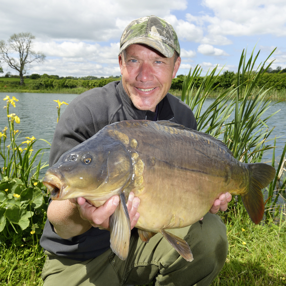 Iain poses with a chunky Blackthorne Fishery boilie-caught carp... what a cracker!
