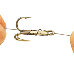 7. Now tightly wrap the wire around the hook's shank three times and then thread it back through the eye.