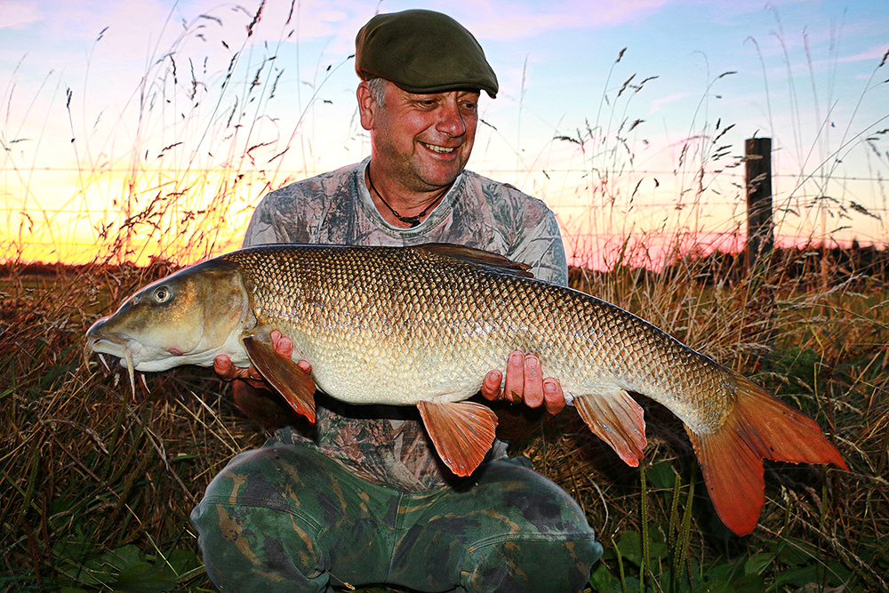 Gary Johnson with his 14lb 12oz barbel from the River Nene.