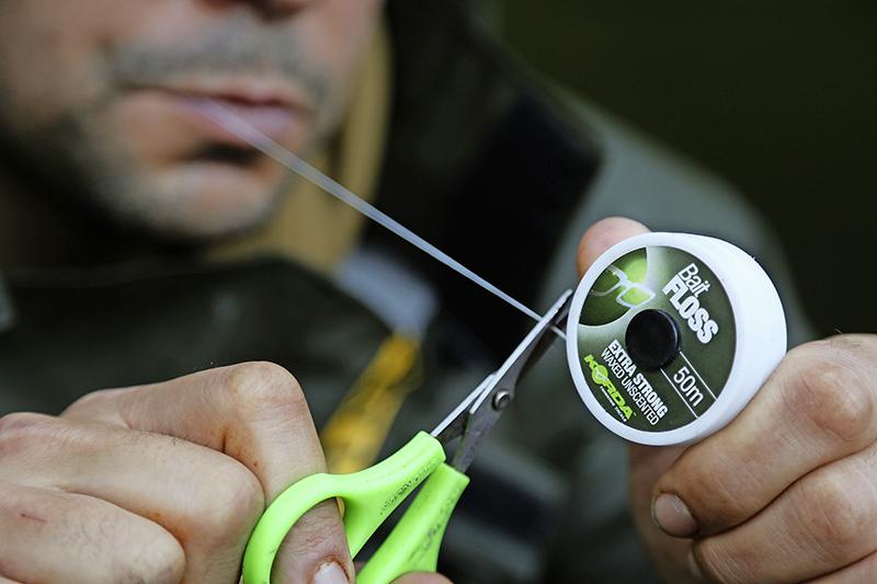 Next, using a pair of sharp braid scissors, cut off a 30cm length of bait floss
