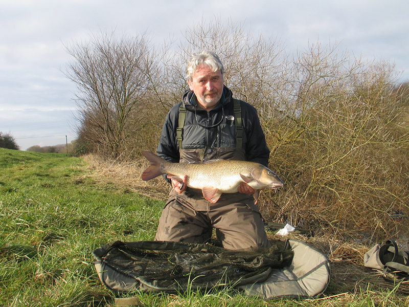 Steve Collins showing off his 14lb 7oz barbel