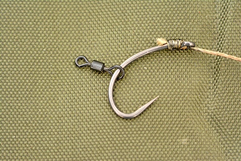 Trim the tag end of the knotless knot and then slide a small rig swivel on to the hook