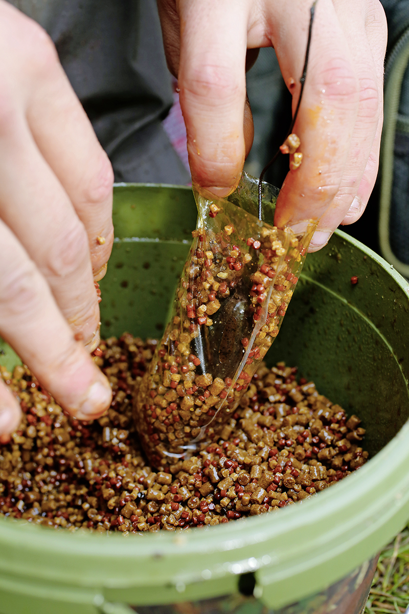 Start by placing a small quantity of your mix in the bag followed by your hookbait. Then add more bait, followed by the lead and then top up with yet more bait mix.