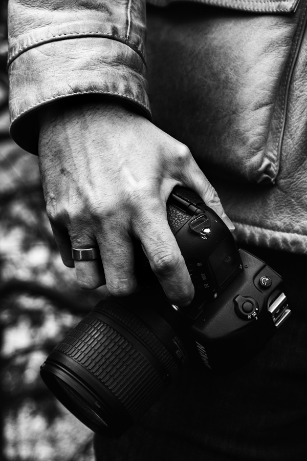 A fellow photographer was using an old Nikon F5 with his craggy hands, both of which carried amazing stories in their own rights.