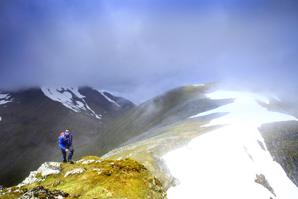 Approaching the summit of Aonach Beag, Ben Nevis beyond. Photograph: Tom Bailey / Trail Magazine