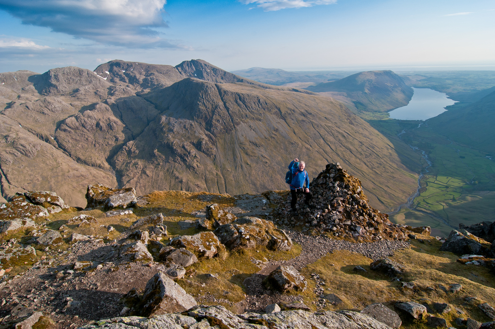 Westmoreland Cairn near the summit of Great Gable in the Lake District, with Wasdale, Scafell and Scafell Pike in the background. Photograph Matthew Roberts / Trail Magazine