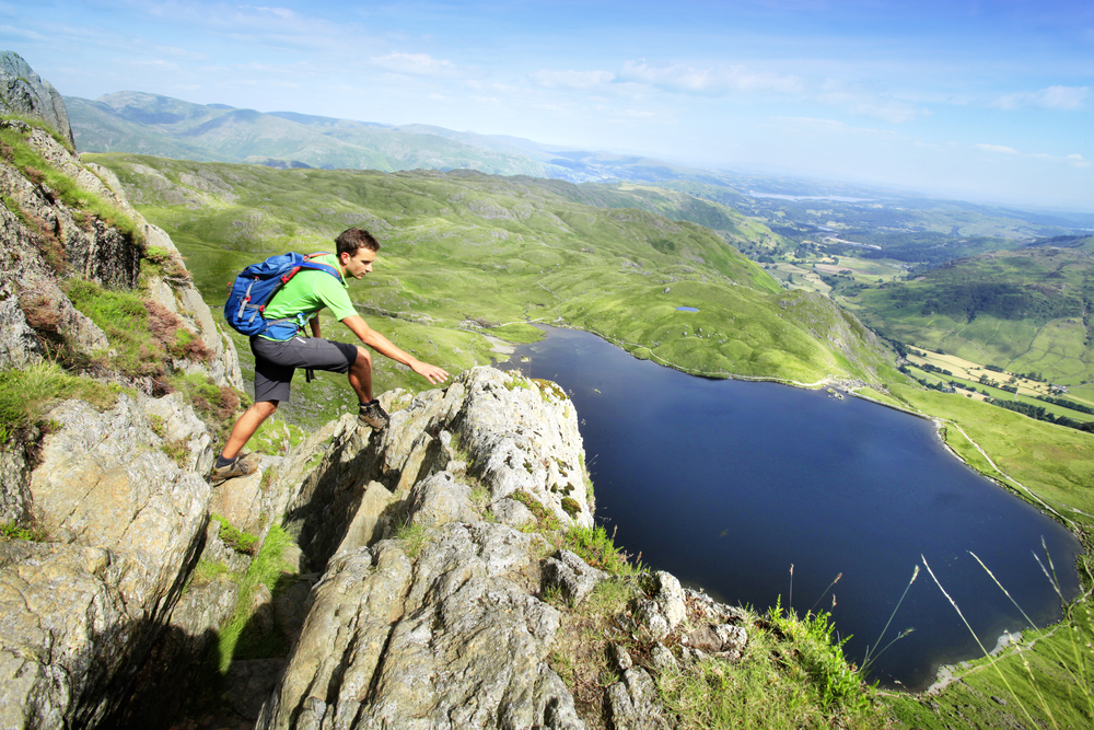 Negotiating the upper reaches of Jack's Rake, high above Stickle Tarn and the Langdale Valley. Photograph: Tom Bailey / Trail Magazine
