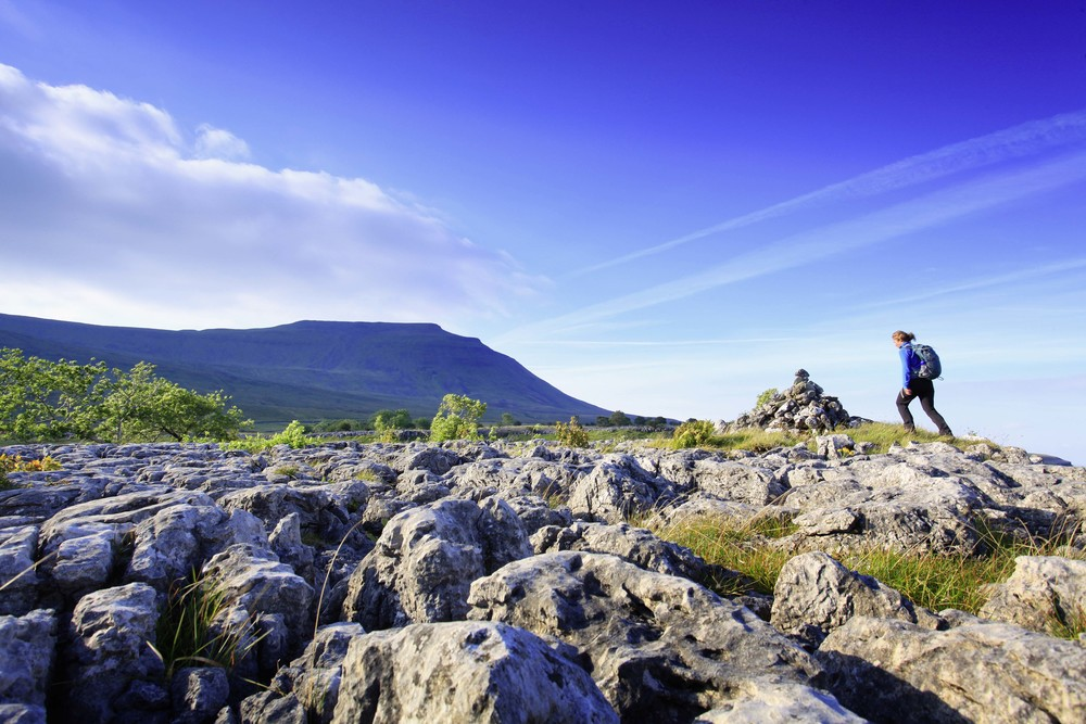 The rather less claustrophobic upside to the underground, with Ingleborough watching. Photo: Tom Bailey / Country Walking