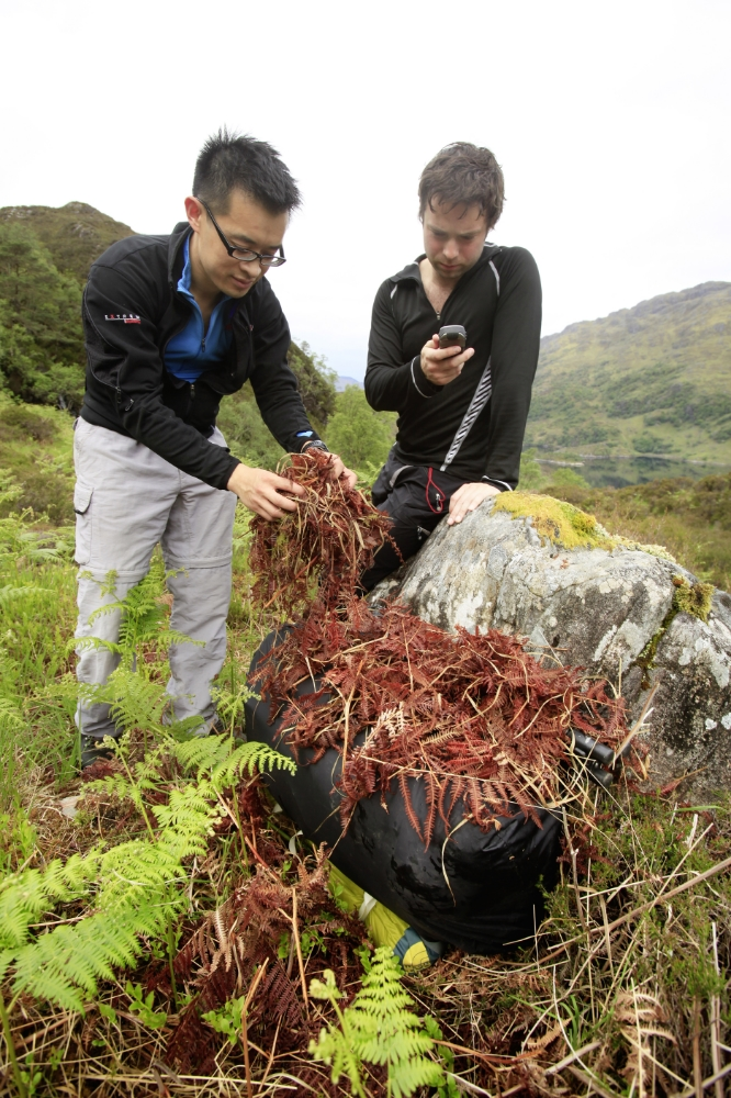 Stashing camping gear in Knoydart and marking position with a GPS device. Wilder places lend themselves to this technique more readily. Photograph: Tom Bailey / Trail Magazine