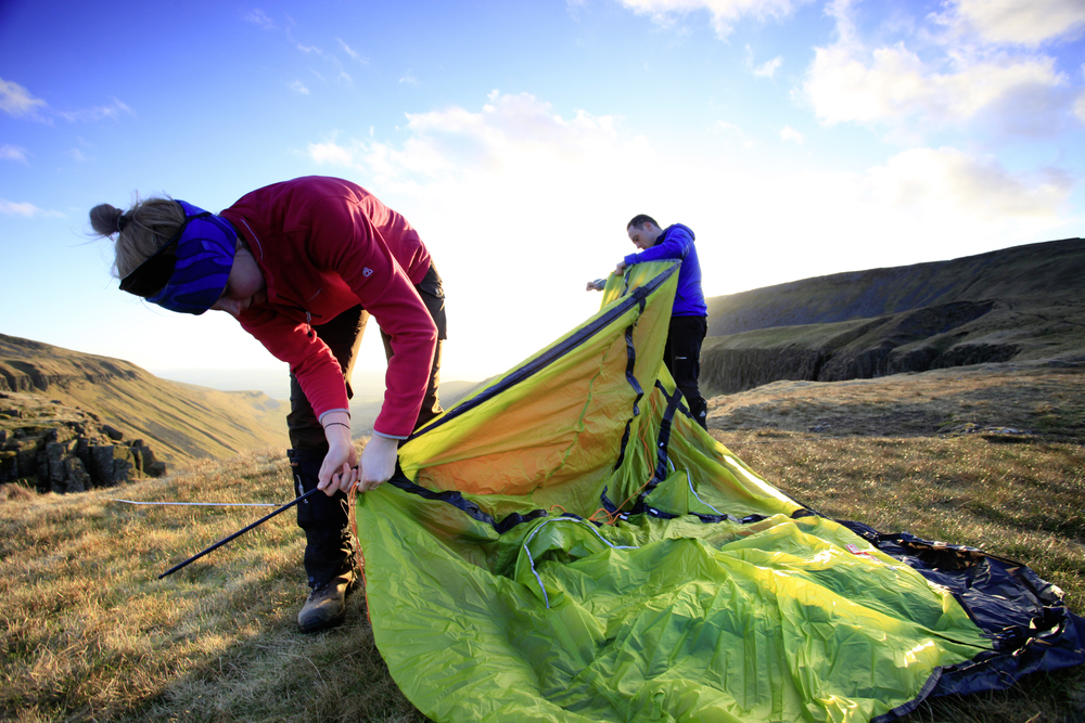 Setting up camp in warming evening light. Photo: Tom Bailey © Trail Magazine