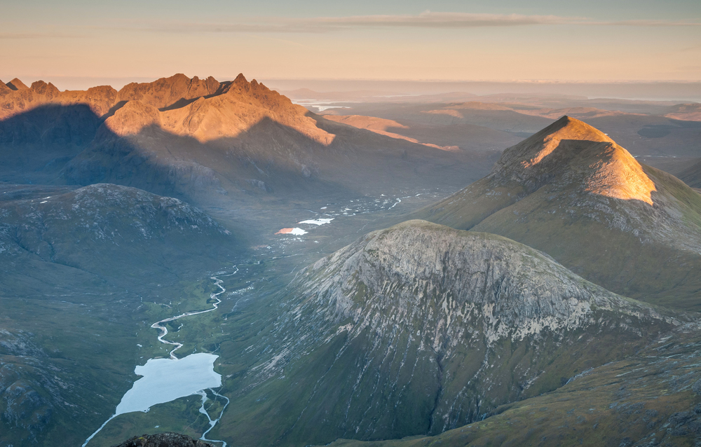 The stunning contrast between the Black (left) and Red Cuillin, from Bla Bheinn. You don't need to be a mountaineer to enjoy this landscape: read on. Photo: Stewart Smith/Alamy